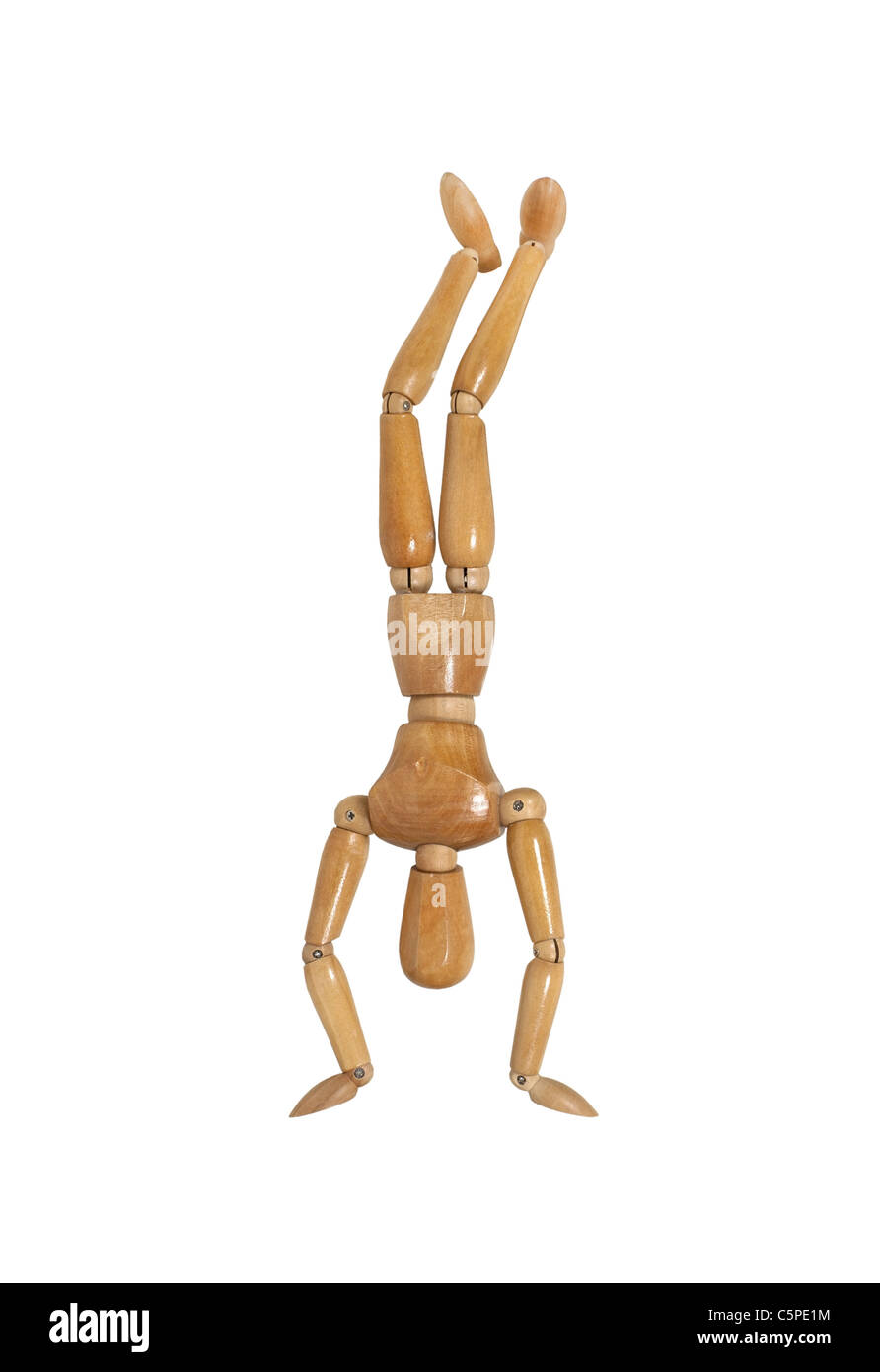 Wooden model representing a person doing a hand stand - path included - Stock Image