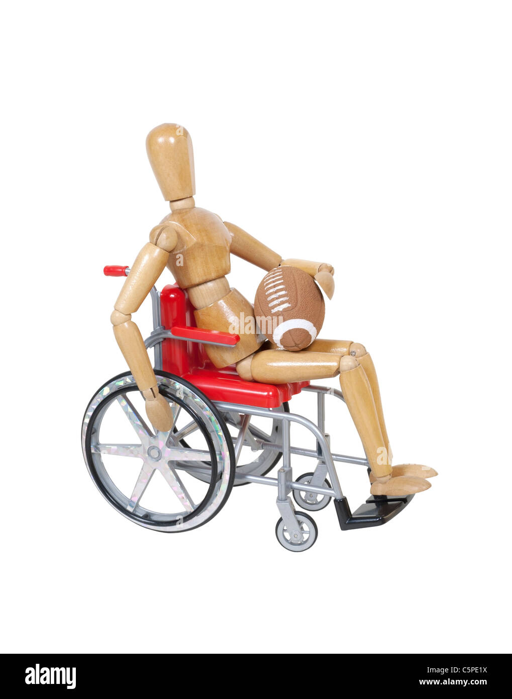 Model in a wheelchair holding a football - path included - Stock Image