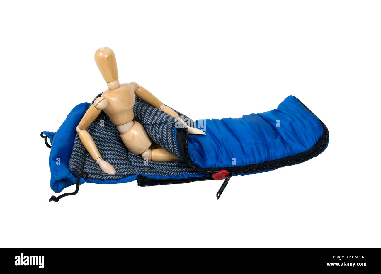 Model sitting up in a sleeping bag used to keep warm on camping trips - path included - Stock Image