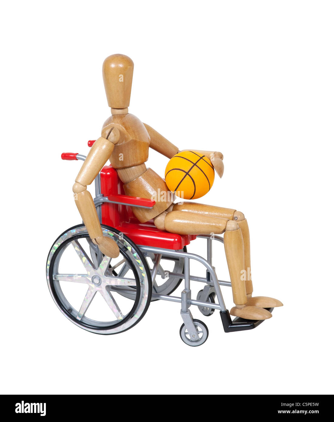 Model in a red wheelchair holding a basketball - path included - Stock Image