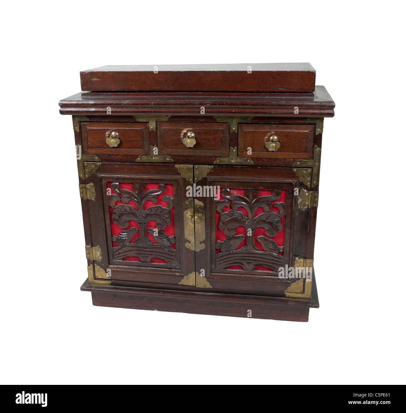 An old antique wooden and brass chest with small drawers for storing various ingredients - path included - Stock Image
