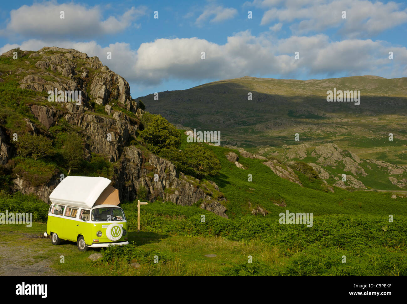 VW camper van parked in rocky landscape in the Duddon Valley, Lake District National Park, Cumbria, England UK - Stock Image