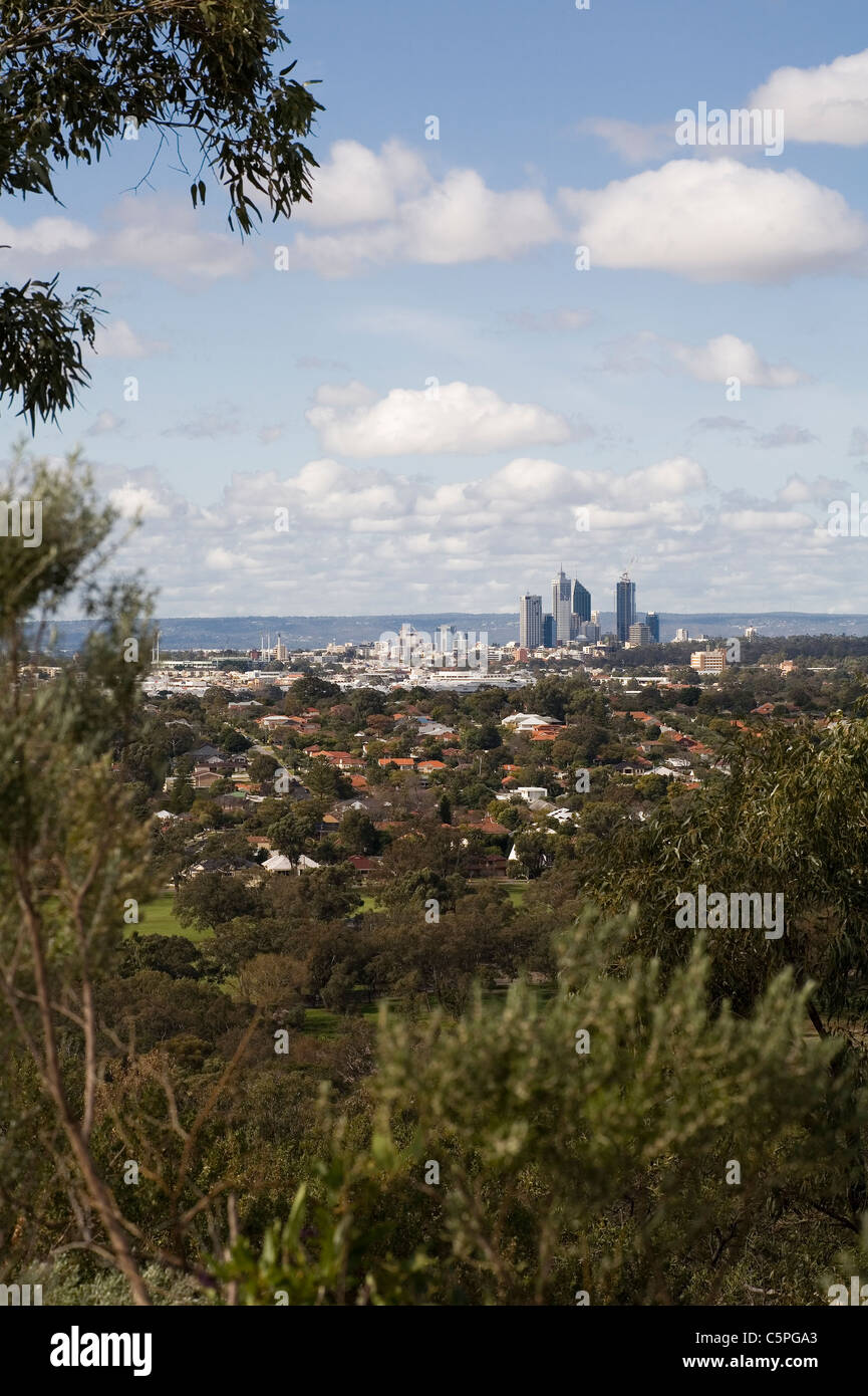 Perth city skyscrapers, Western Australia. As viewed across the western suburbs from Reabold hill in Bold Park. - Stock Image