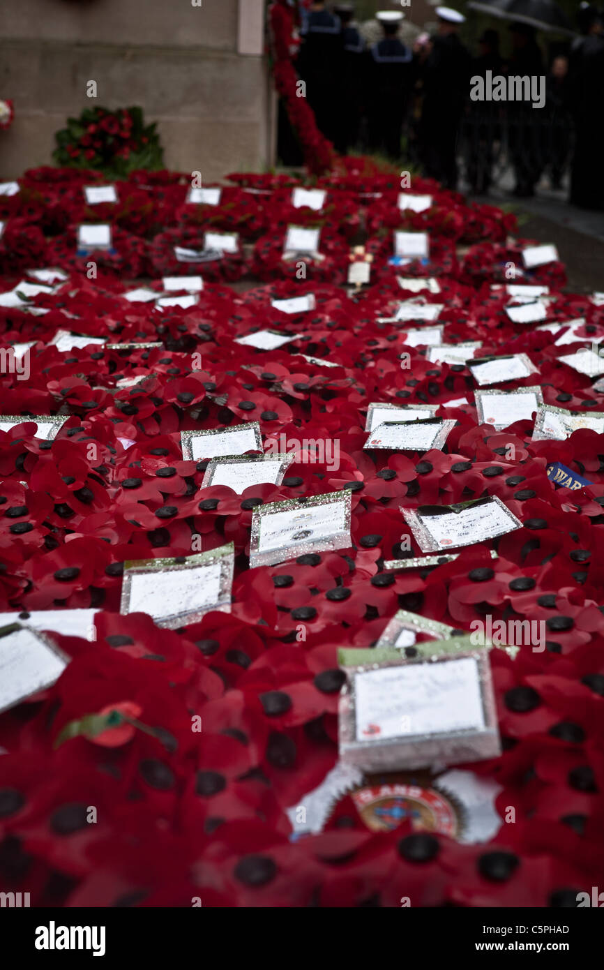 The sea of poppy wreaths laid in front of the Cenotaph in Whitehall on Remembrance Day. - Stock Image