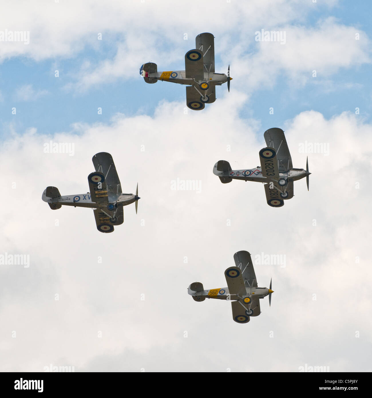 Four vintage bi-planes flying in formation, Duxford air show 2011 - Stock Image