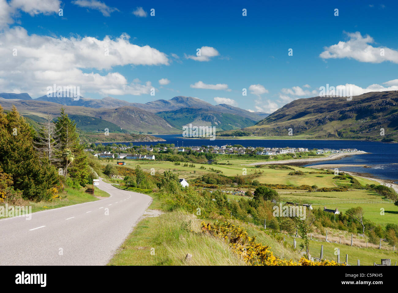 The A835 main road and view over Ullapool and Loch Broom, Ross and Cromarty, Highland, Scotland, UK - Stock Image