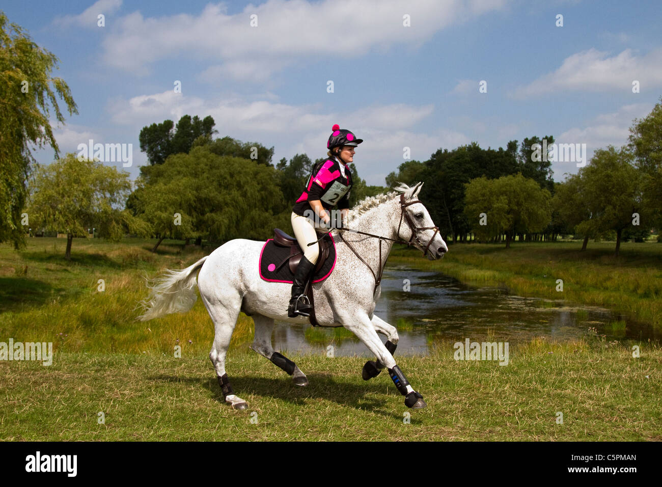 Cross-country Lakeside Gallop_Cross Country at the Subaru Cholmondeley Castle Horse Trials _ Sat 30th-Sun 31st July, - Stock Image
