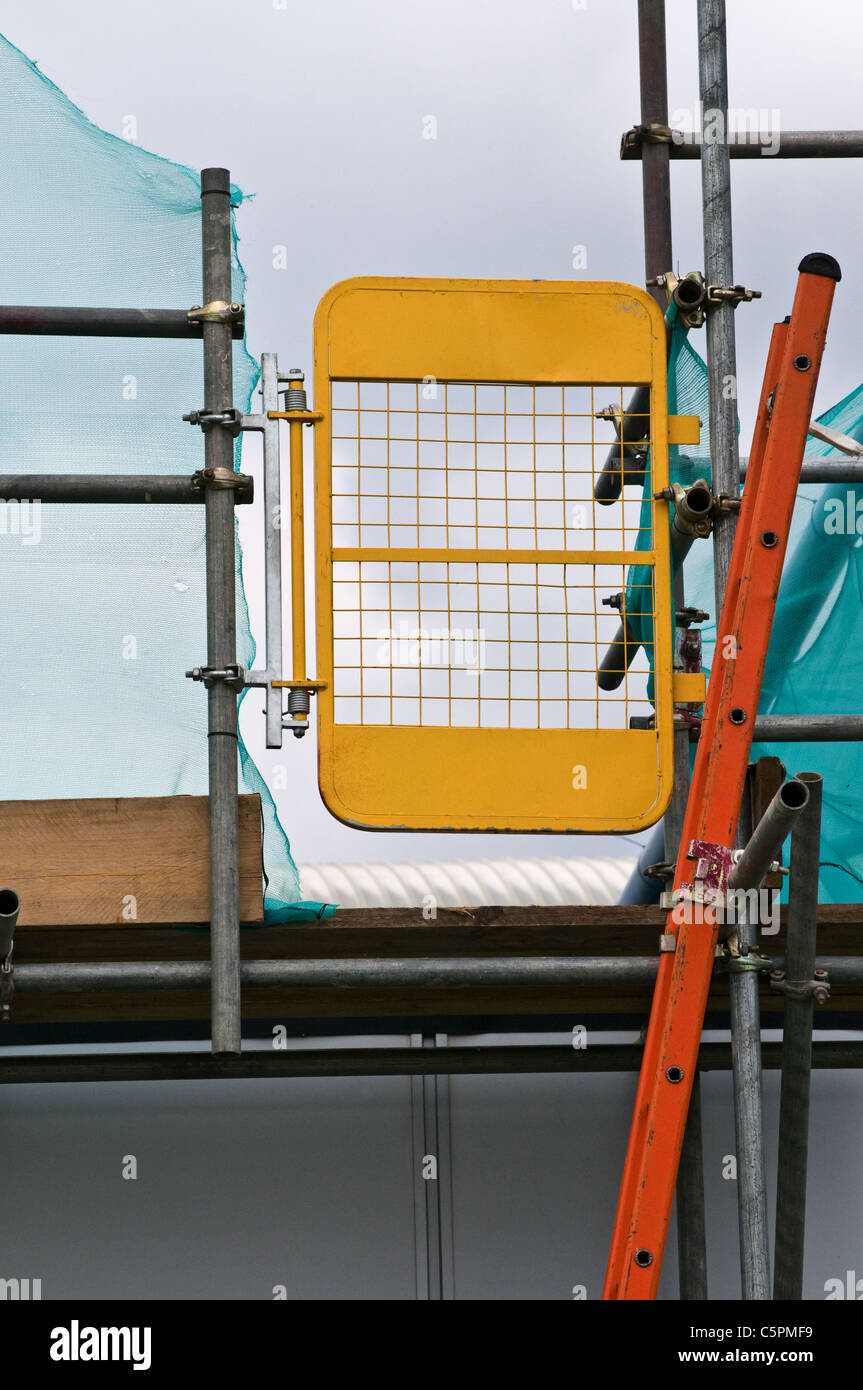 Safety scaffolding door, top of ladder at roof level - Stock Image