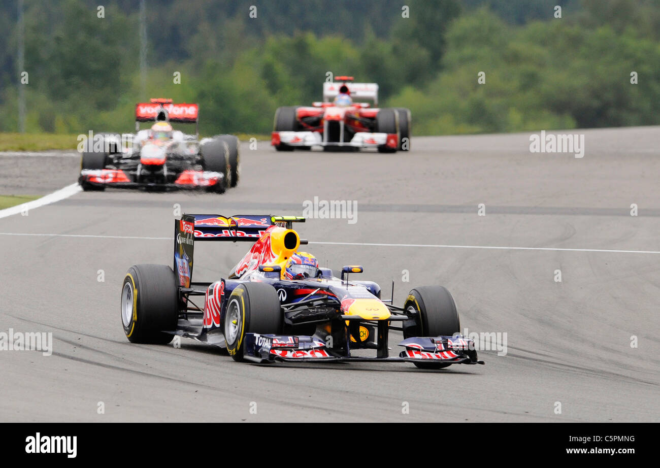 Mark Webber, Red Bull in front of Lewis Hamilton , McLaren Mercedes and Fernando Alonso , Ferrari, during the German - Stock Image