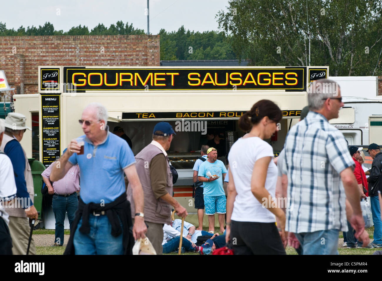Gourmet Sausage trailer at a public event - Stock Image
