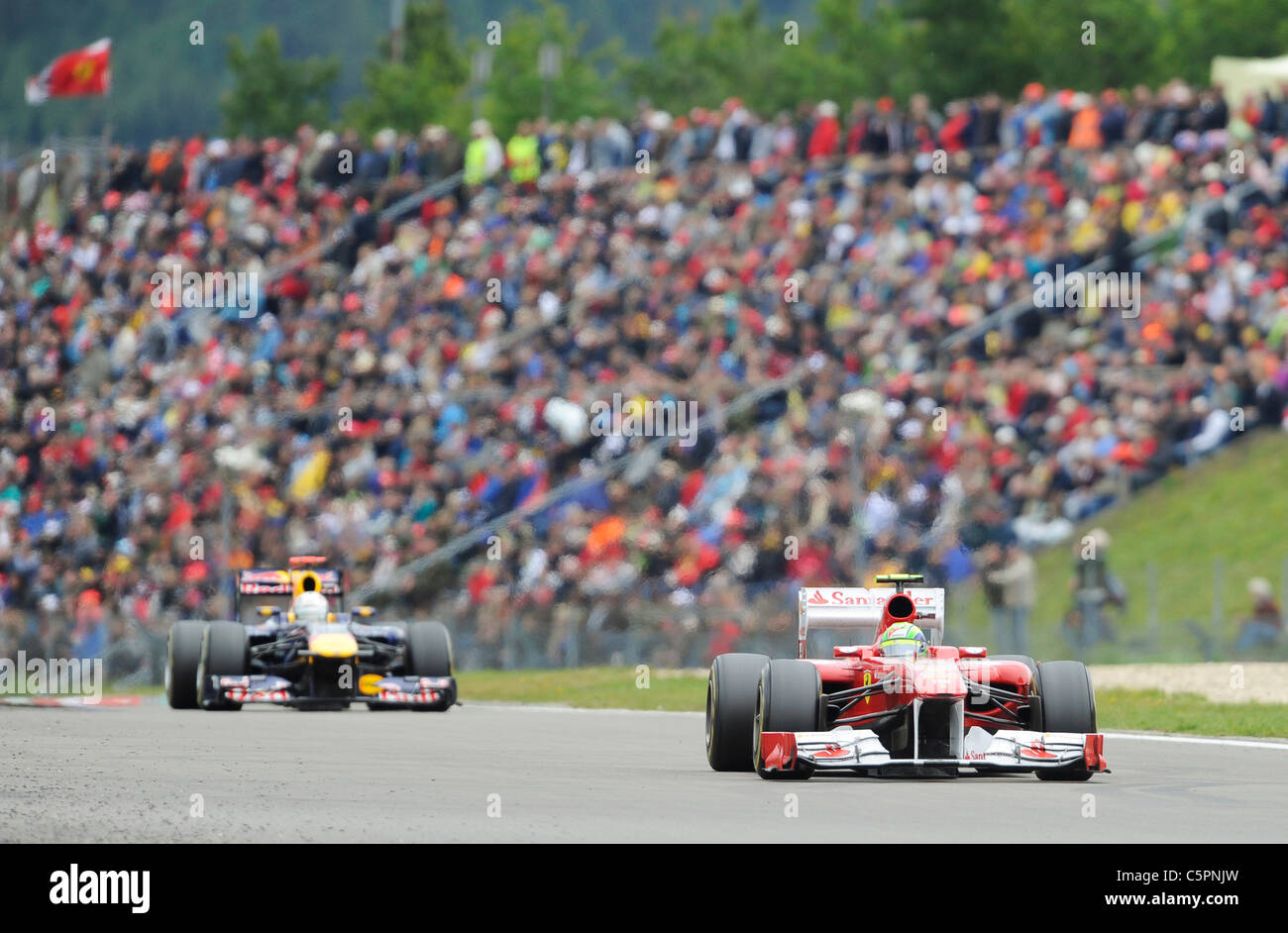 Massa and Vettel in front of the crowds at the German Formula One Grand Prix on Nürburgring racetrack in Germany - Stock Image