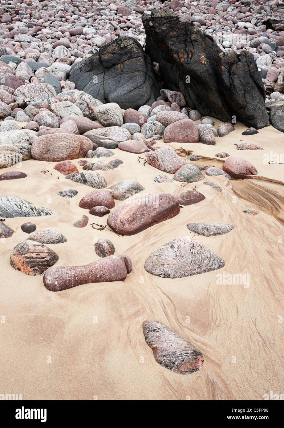 Stones and pebbles on the beach at Oldshoremore, Sutherland, Highland, UK. - Stock Image