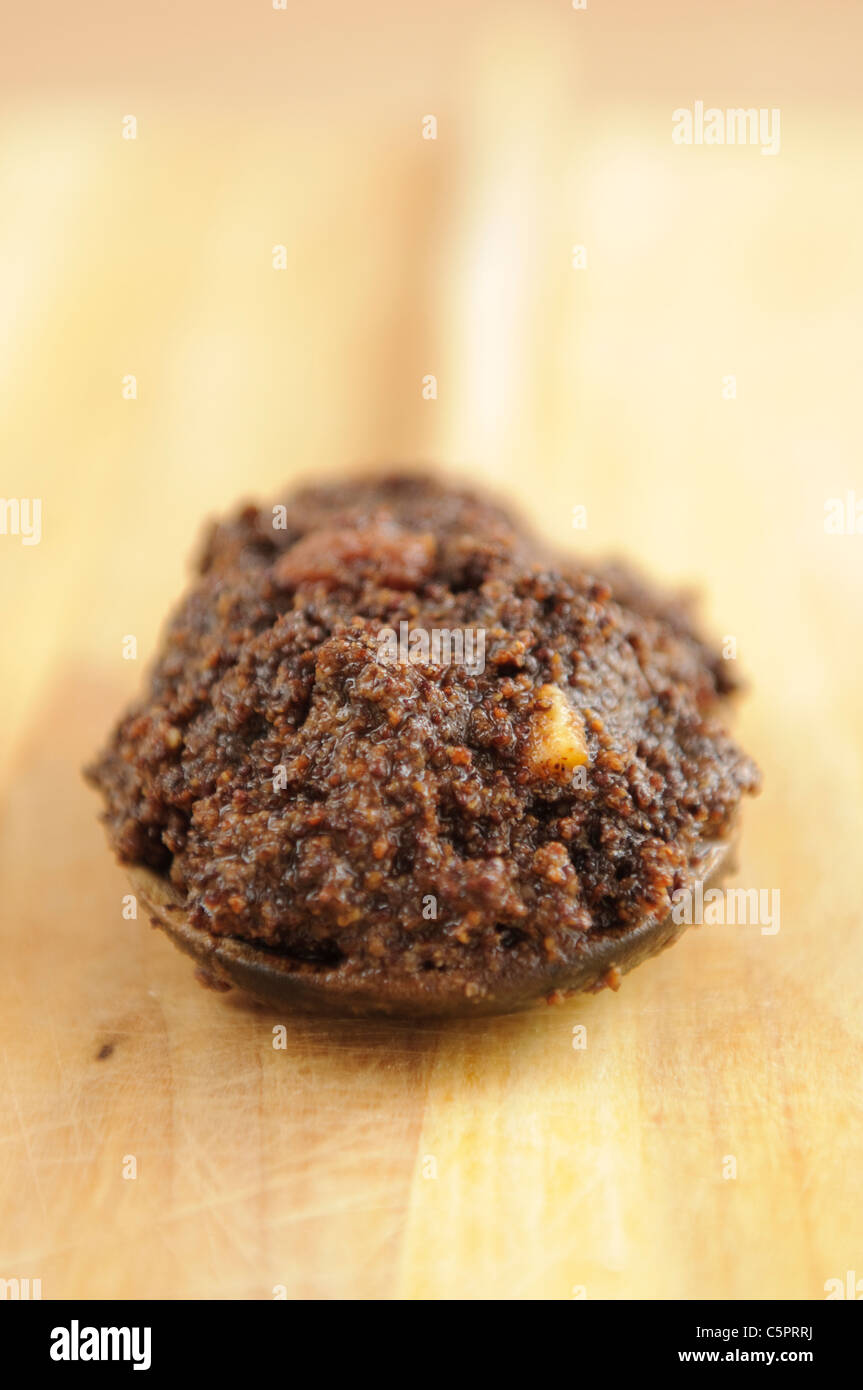 Traditional filling with poppy seed and raising used to cook cakes and desserts - Stock Image