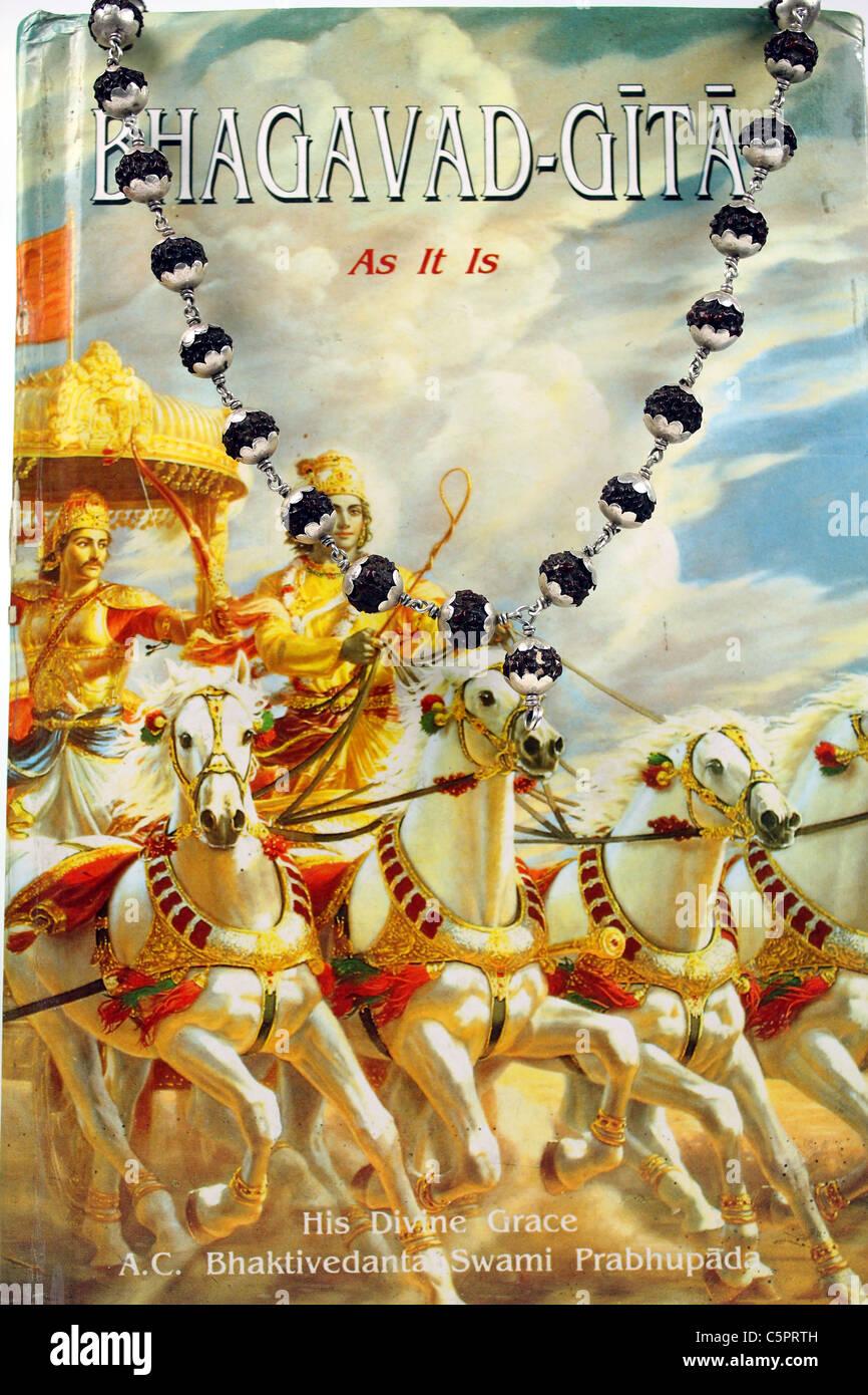bhagavad gita and rudraksh beads - Stock Image