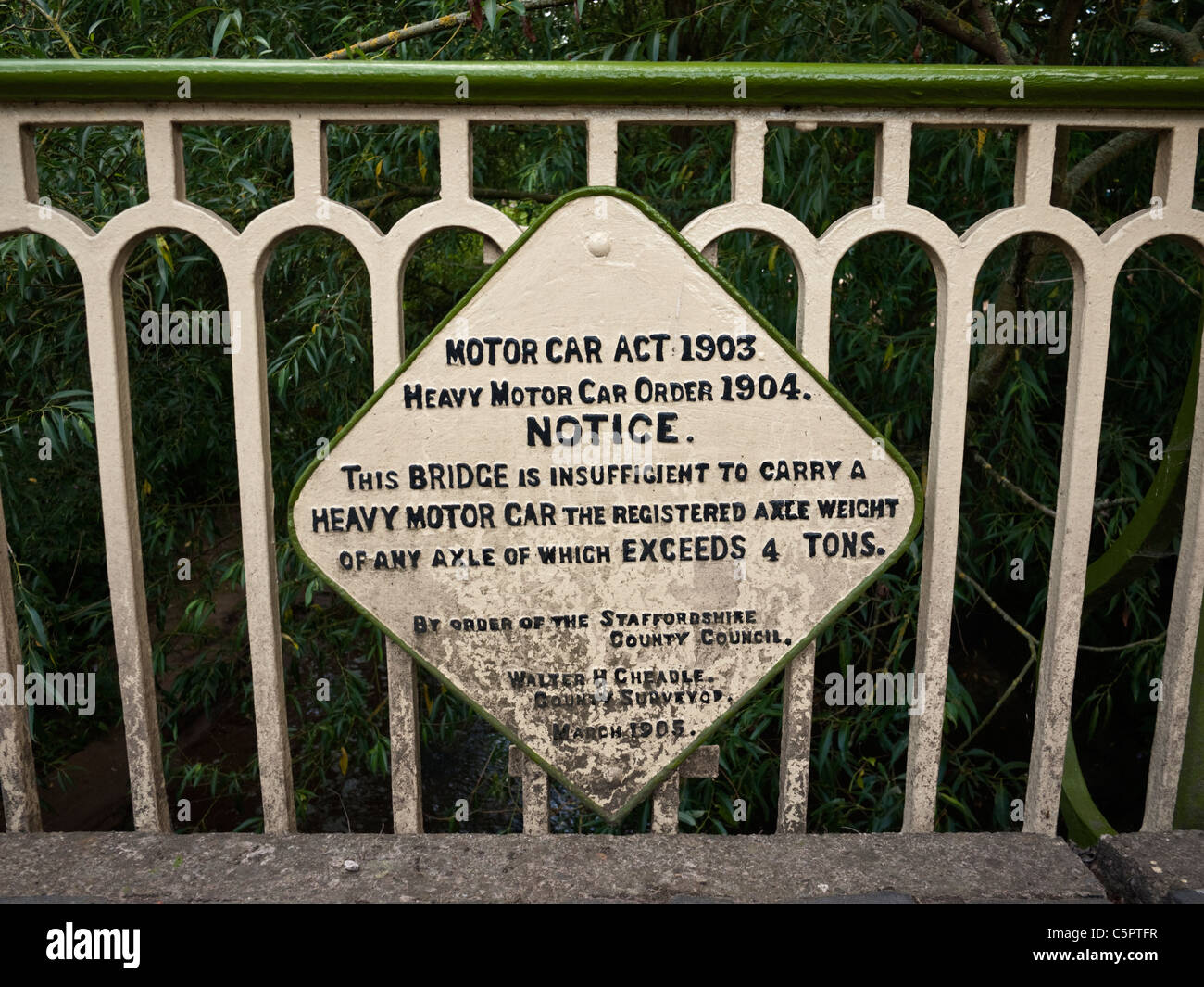 Old road sign from the Motor Car Act 1903 on a road bridge in the South Staffordshire village of Trysull - Stock Image