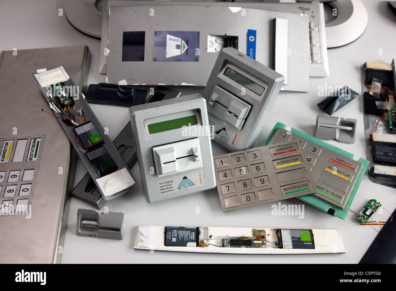 Skimming devices for manipulation a cash machine, ATM. MIcro cameras or keyboards register the PIN code of a bank - Stock Image