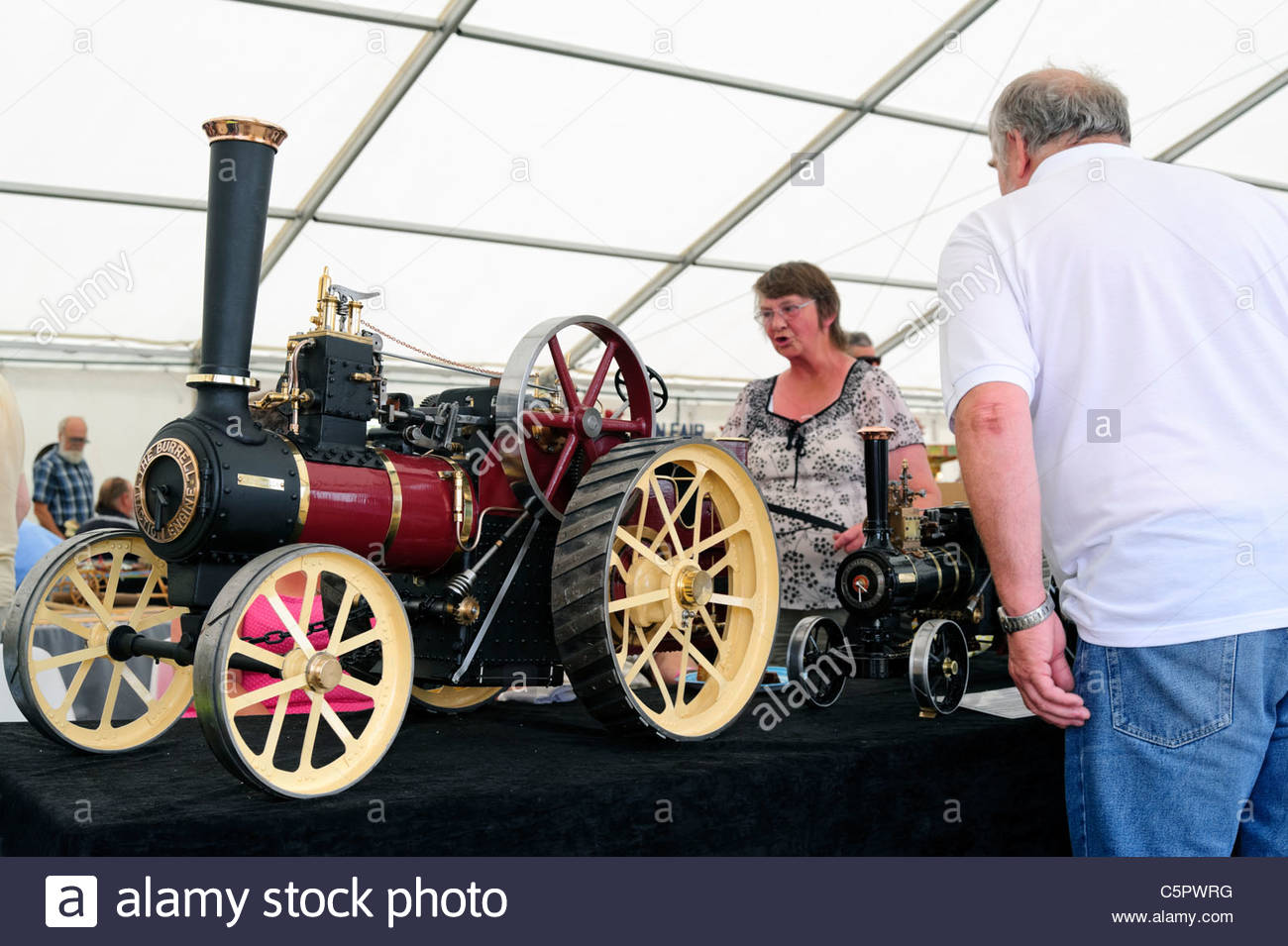 People looking at model steam engines, at Welland Steam Rally 2011, England, UK. - Stock Image