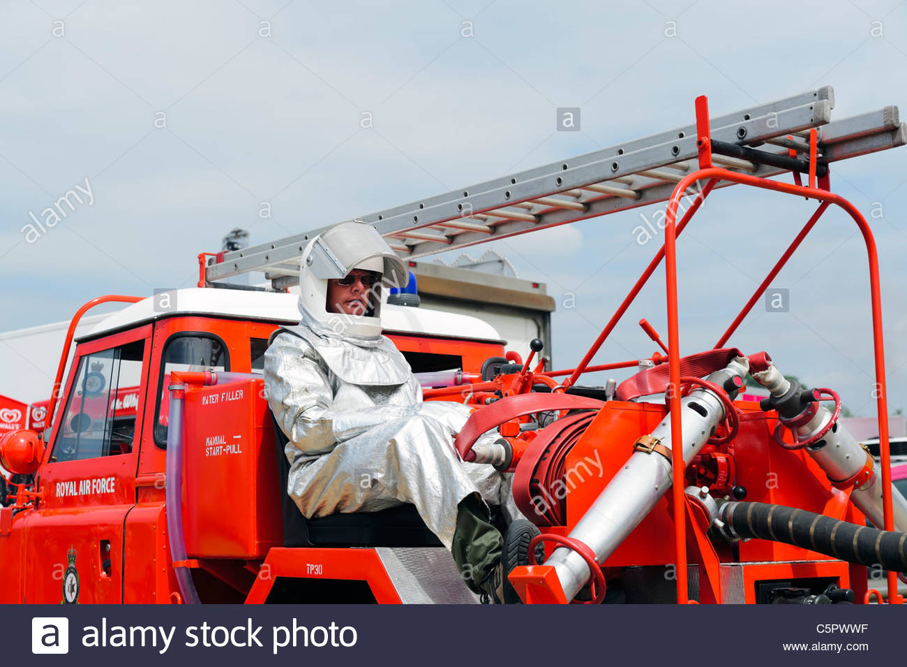 73b883c76dfa RAF fire fighter wearing silver fireproof suit