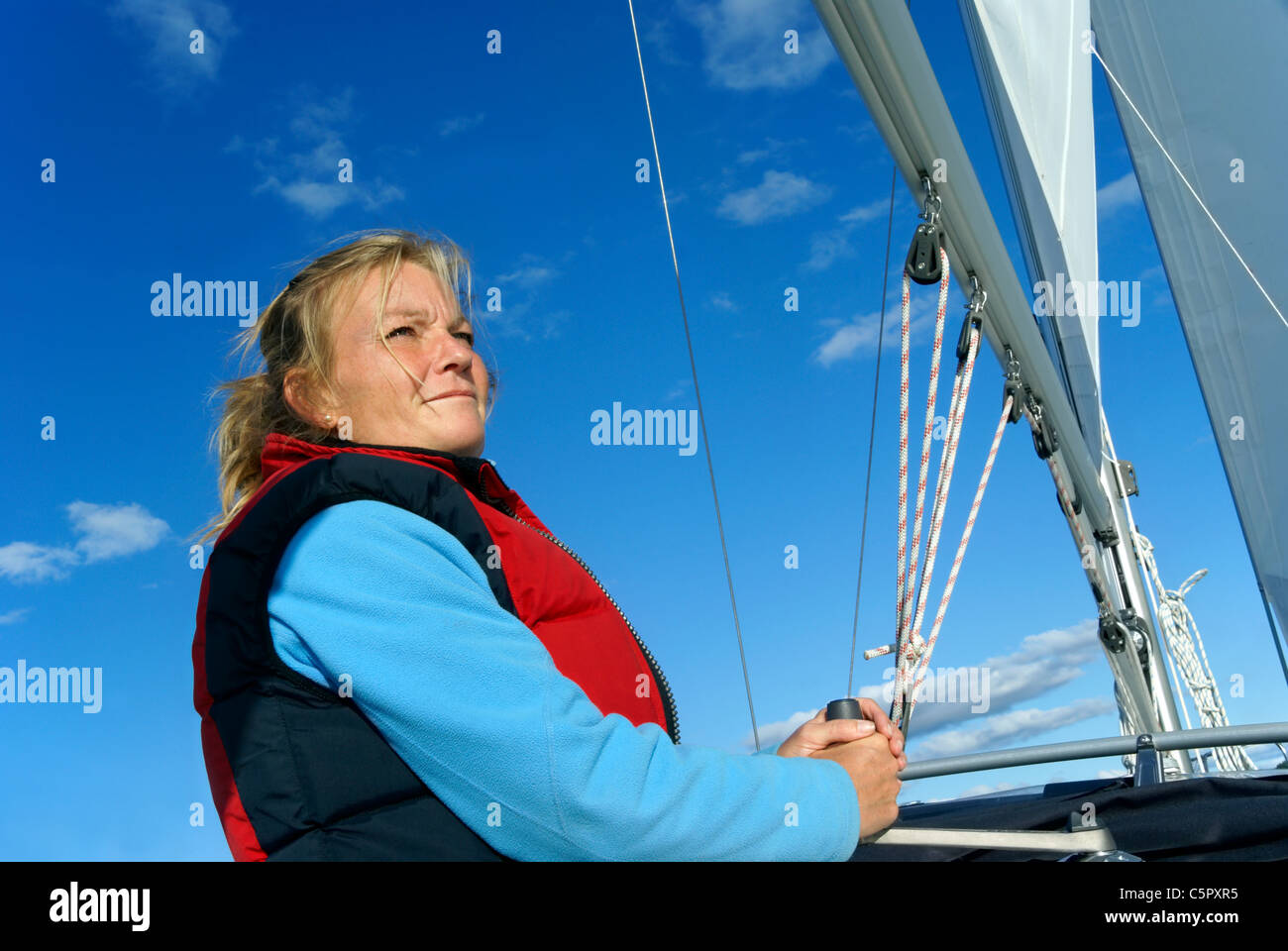 Blond woman sailing yacht (Model Release) Stock Photo