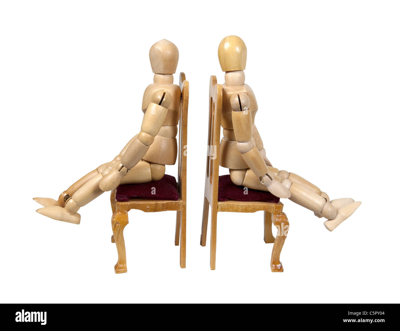 Disagreement shown by two people sitting in chair facing away from each other - path included - Stock Image