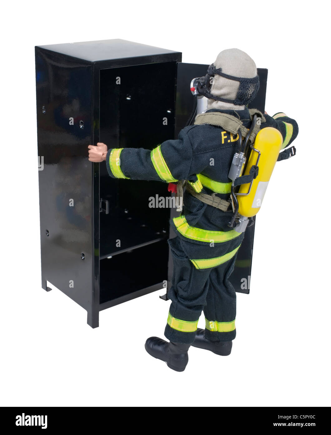 Fireman in front of a locker in protective gear used for fighting fires and saving lives - path included - Stock Image