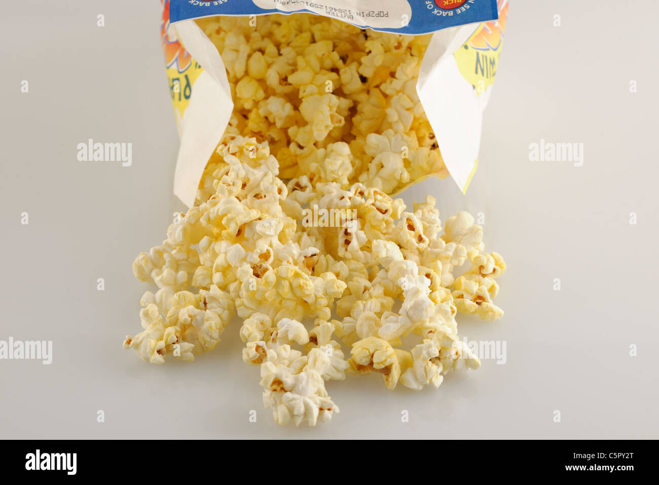 Pile of freshly microwaved butter microwave popcorn. - Stock Image