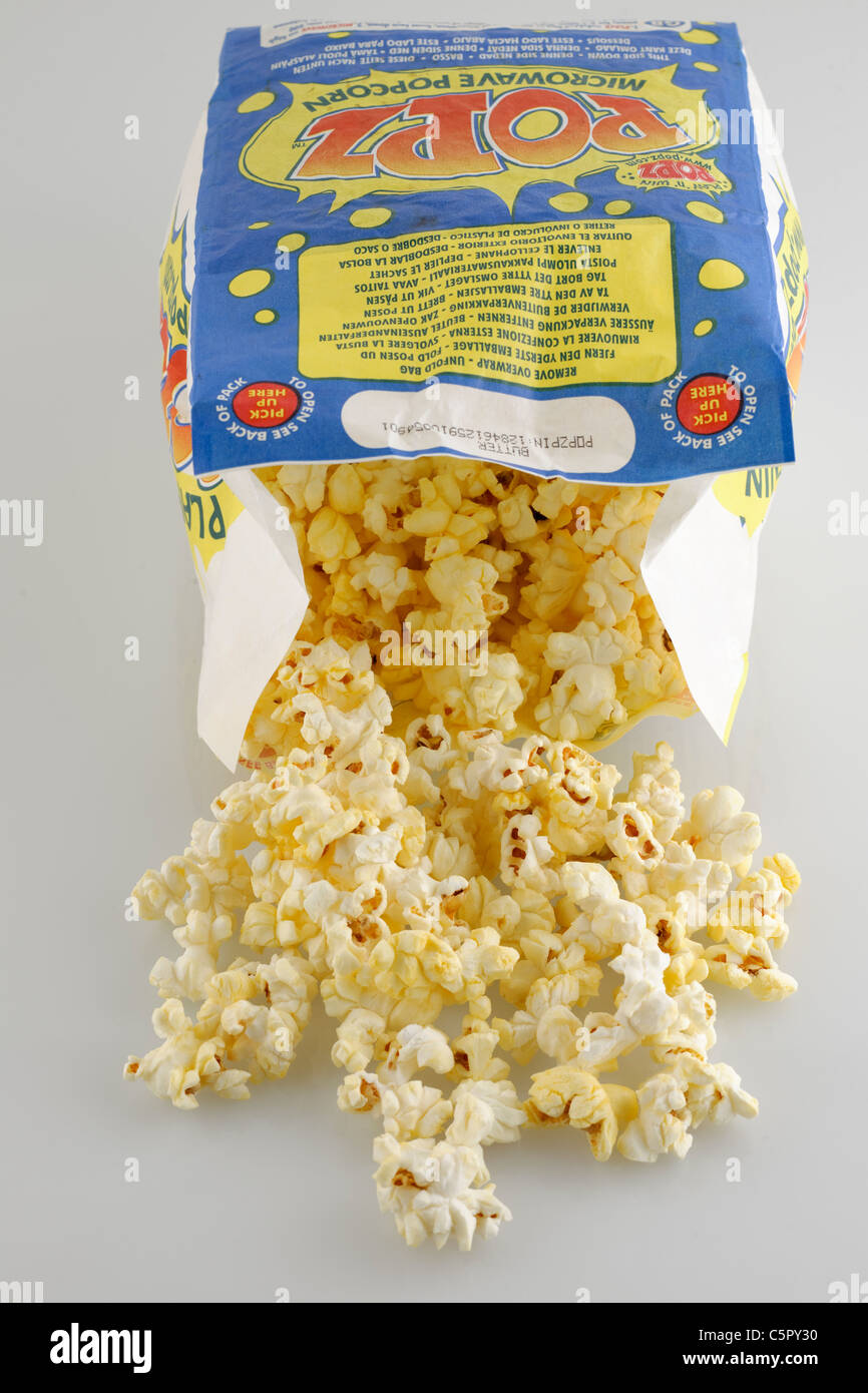 Packet of freshly microwaved Popz butter microwave popcorn. - Stock Image
