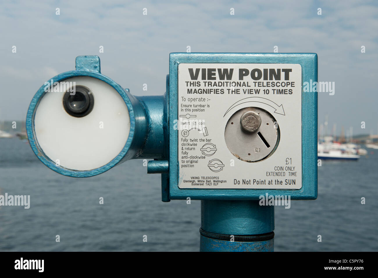 A public coin-operated telescope overlooking the the Packet Quay in Falmouth, Cornwall. - Stock Image