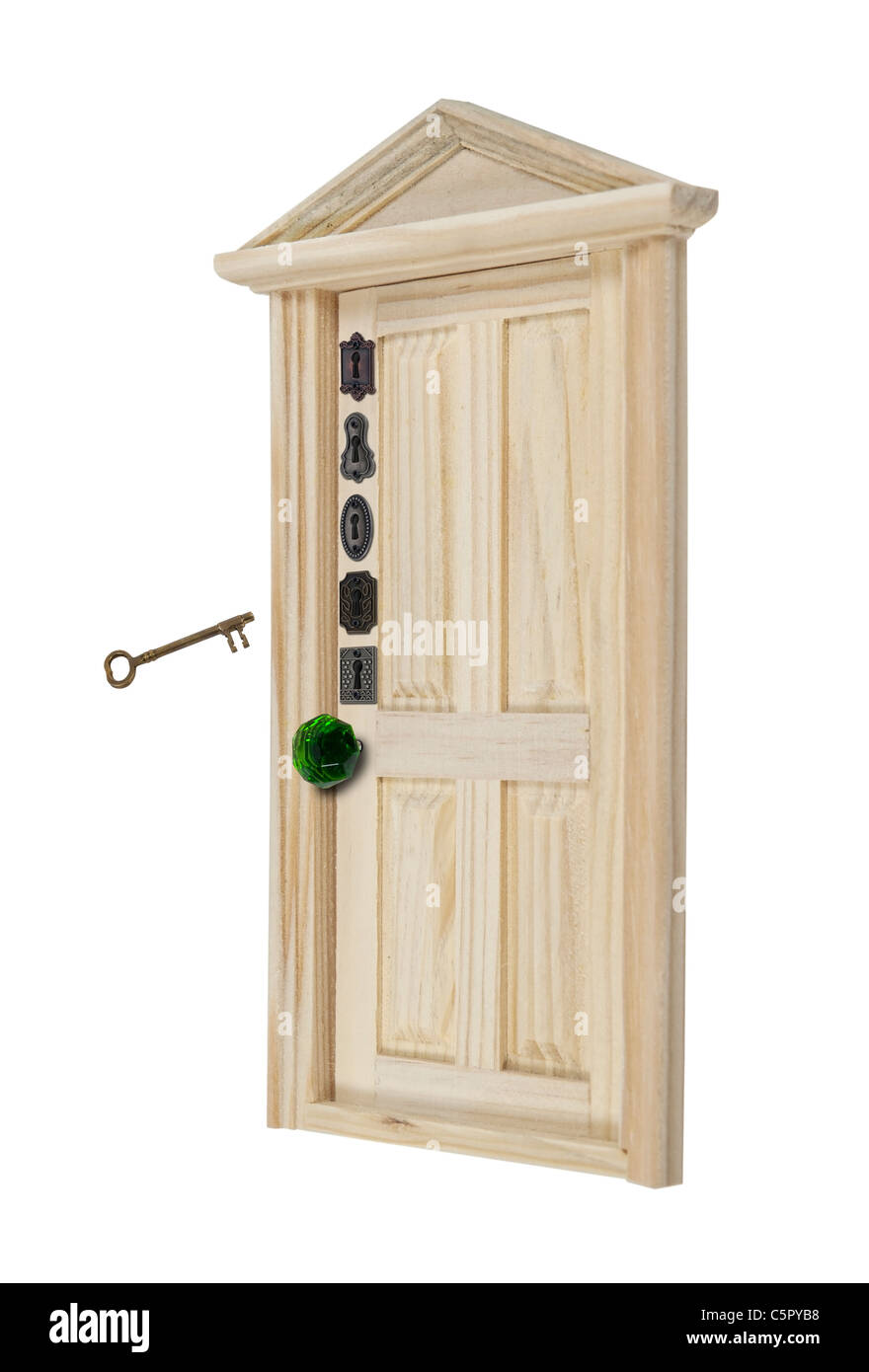 Home security shown by a wooden door with a variety of locks - path included - Stock Image