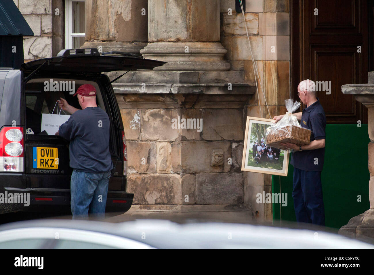 Wedding gifts for Zara Phillips and Mike Tyndall are loaded into a car  the Palace of Holyroodhouse the day after - Stock Image