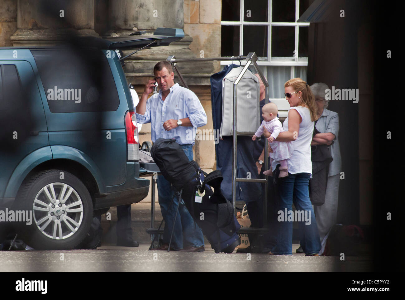 Peter Phillips and family leave the Palace of Holyroodhouse the day after his sister, Zara Phillips' wedding - Stock Image