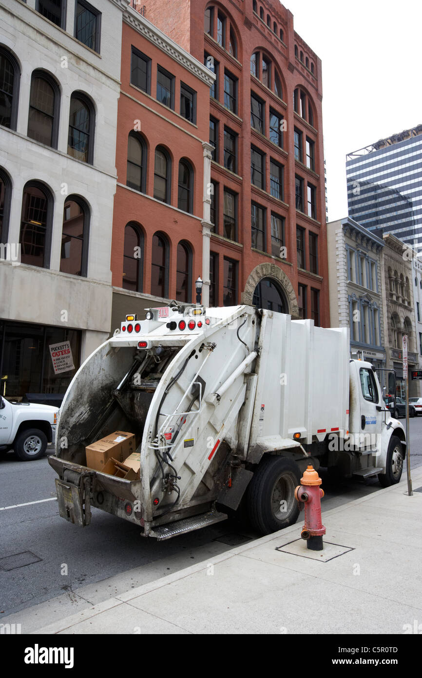 cardboard garbage in refuse truck Nashville Tennessee USA - Stock Image