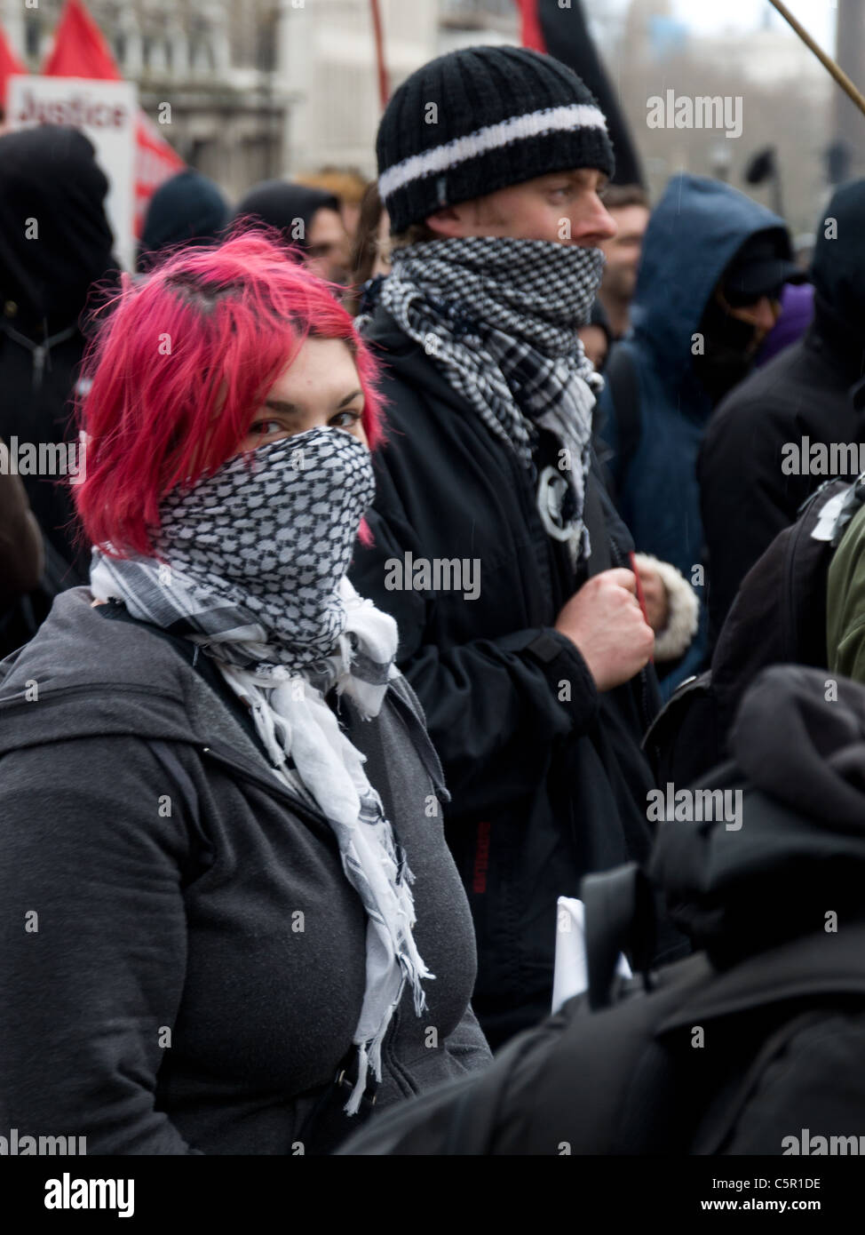 Female anarchist with red hair and bandana covering her face at G20 March in London on 28th March 2009 - Stock Image