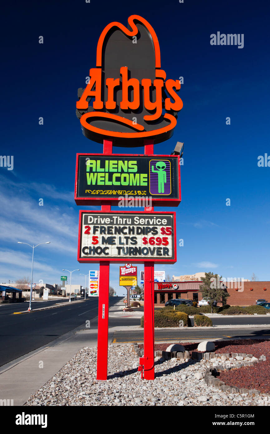 Arby's sign with Aliens Welcome display, Roswell, New Mexico, United States of America - Stock Image