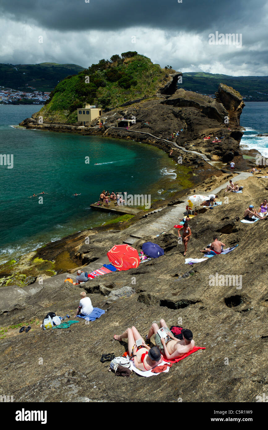 Tourists at Ilhéu Vila Franca, a volcanic crater lagoon islet off the coast at Vila Franca do Campo, São - Stock Image