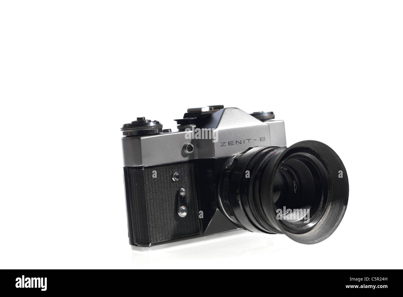 Old fashioned 'retro' Soviet era Zenith 35mm camera on white background - Stock Image