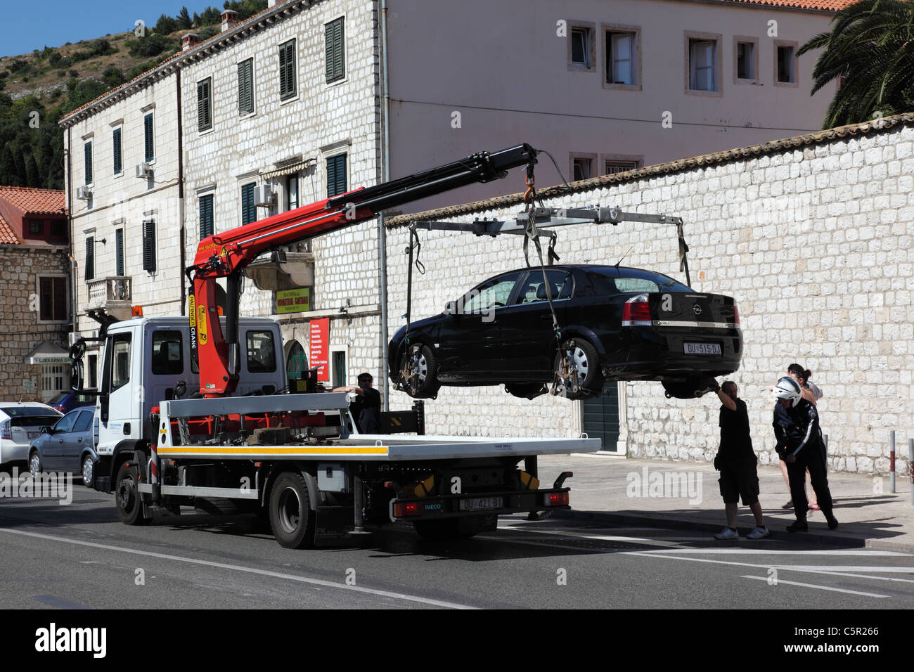 An illegally parked car being removed in Lapad, Durbovnik, Croatia - Stock Image