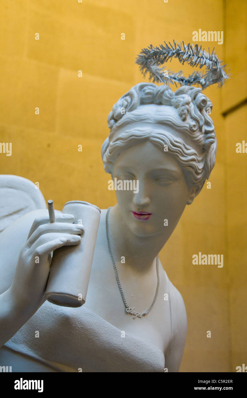 Banksy statue of angel smoking and drinking from a can, The Bristol City Museum and Art Gallery, Bristol, England - Stock Image