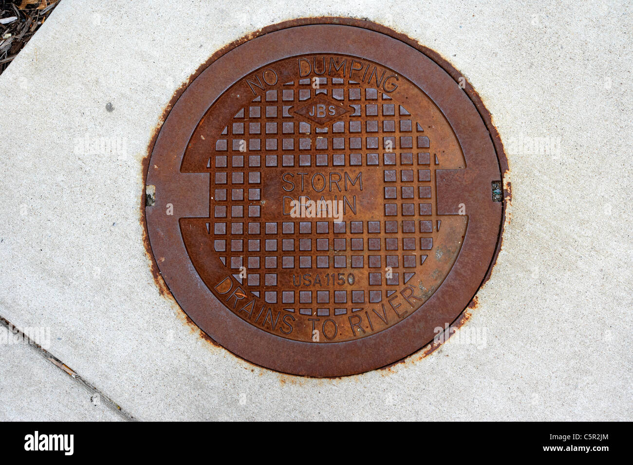 no dumping storm drain man hole cover drains to river Nashville Tennessee USA - Stock Image