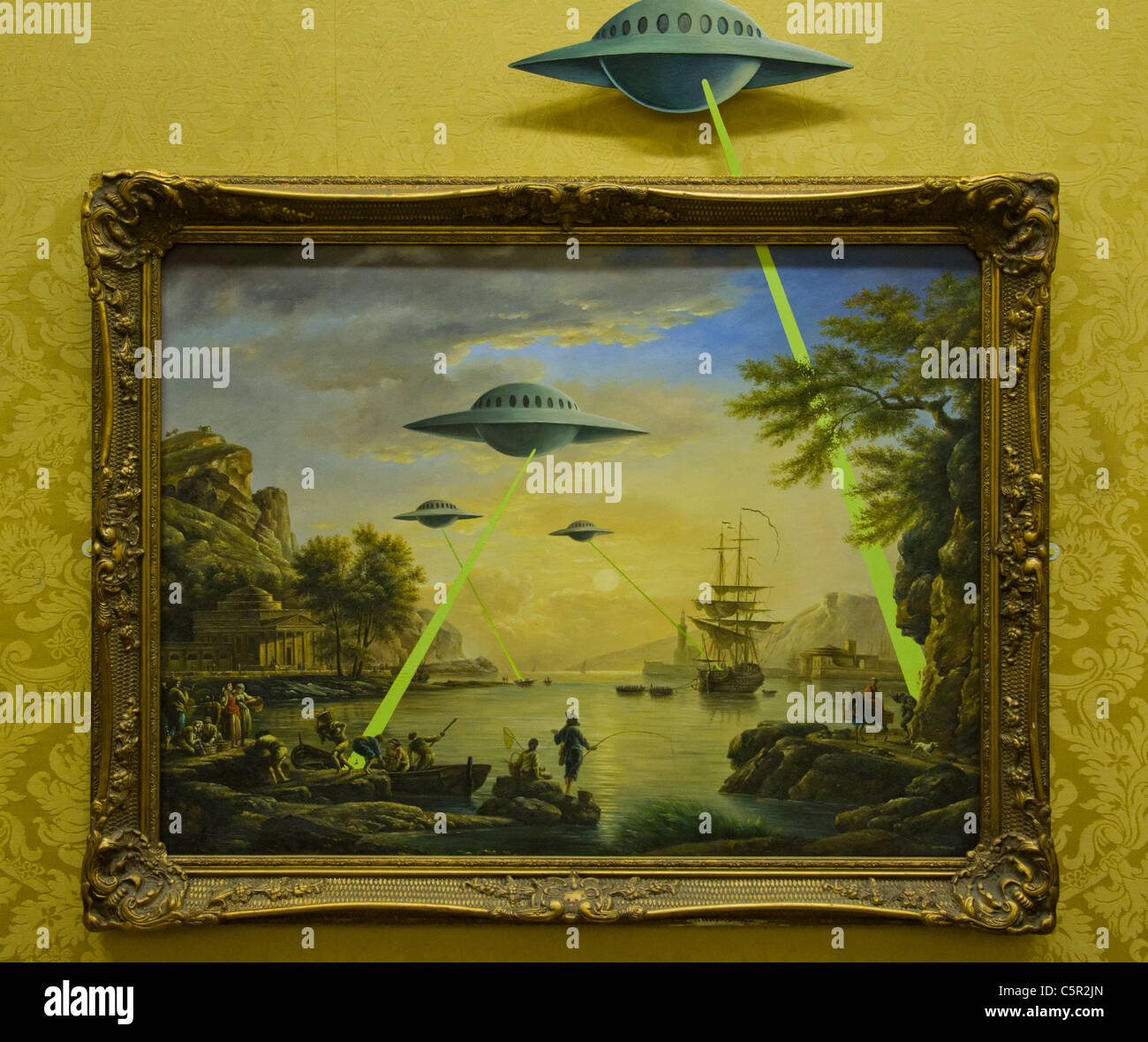 Banksy picture of traditional habour landscape with UFOs shooting lasers into it - Stock Image
