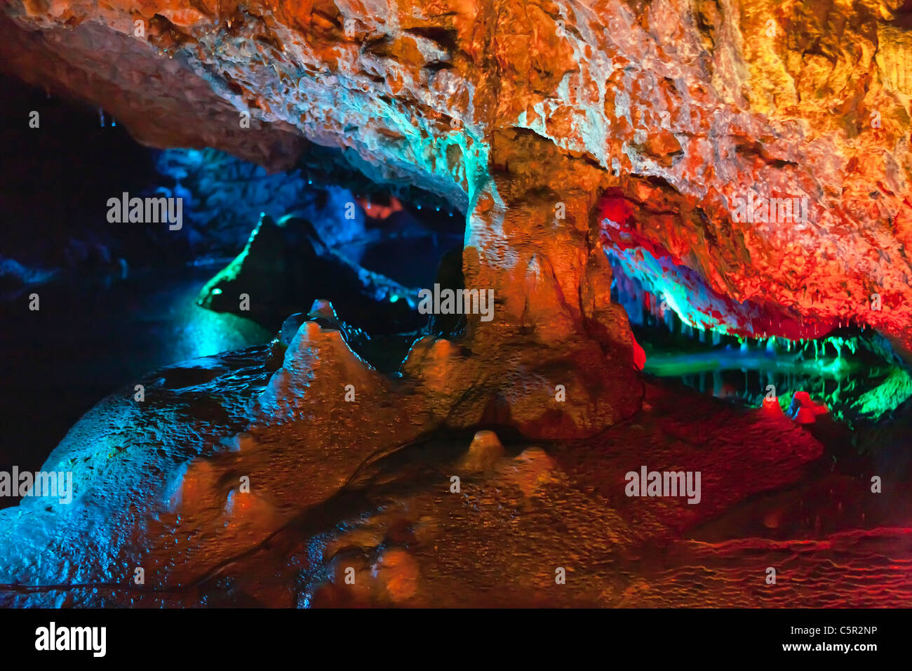 Spotlit cave formations at Wookey Hole - Stock Image