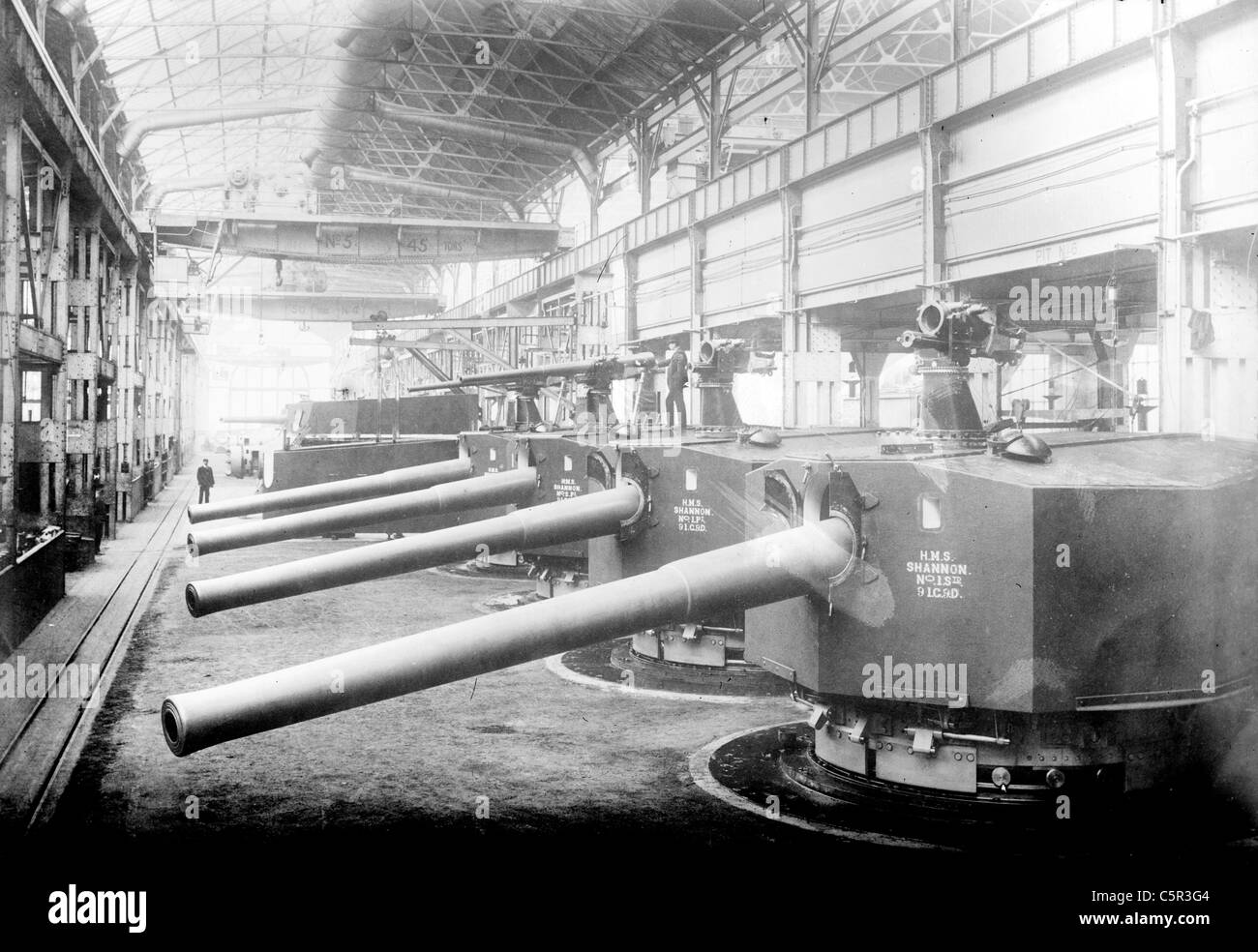 Row of guns for H.M.S. Shannon in Vickers Sons & Maxims Gun Works - Stock Image
