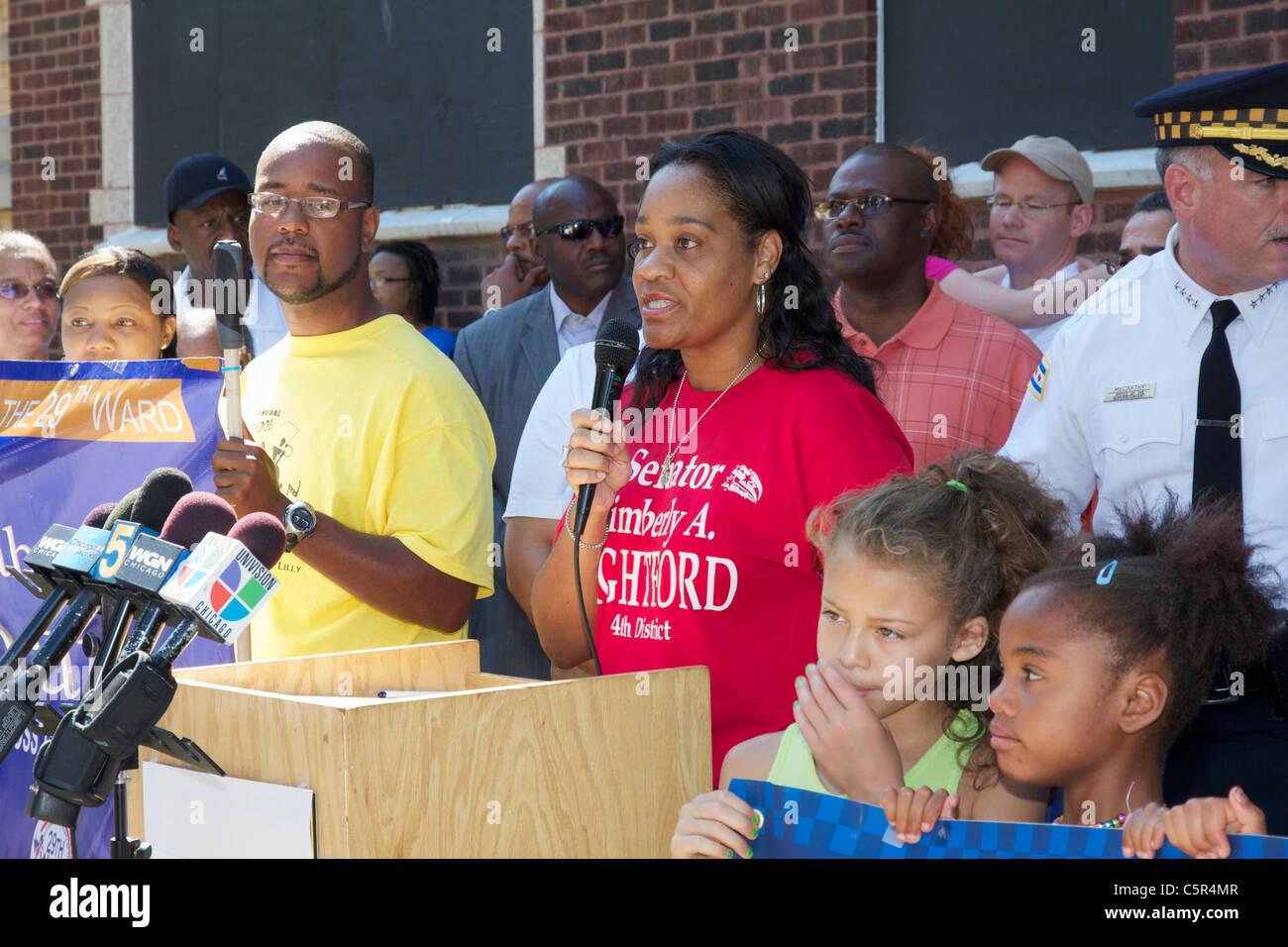 Illinois State Senator Kimberly Lightford speaks at an anti-violence rally in Chicago's Austin neighborhood. - Stock Image