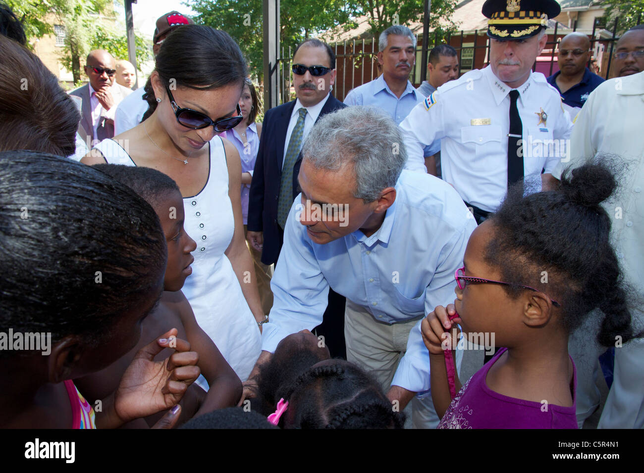 Chicago Mayor Rahm Emanuel chats with children at an anti-violence rally in the city's Austin neighborhood. - Stock Image