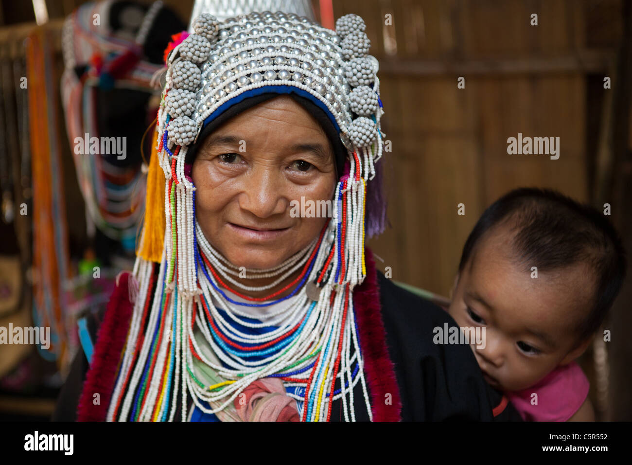 The Akha are a hill tribe who live in small villages in the mountains of China, Laos, Myanmar and Thailand. - Stock Image