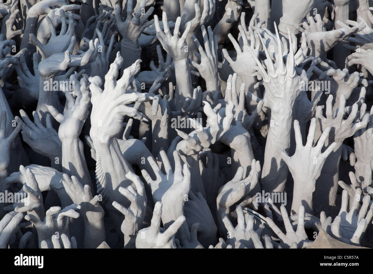 Wat Rong Khun samsara shows the failures of enlightenment with grotesque 'gargoyles' - Stock Image