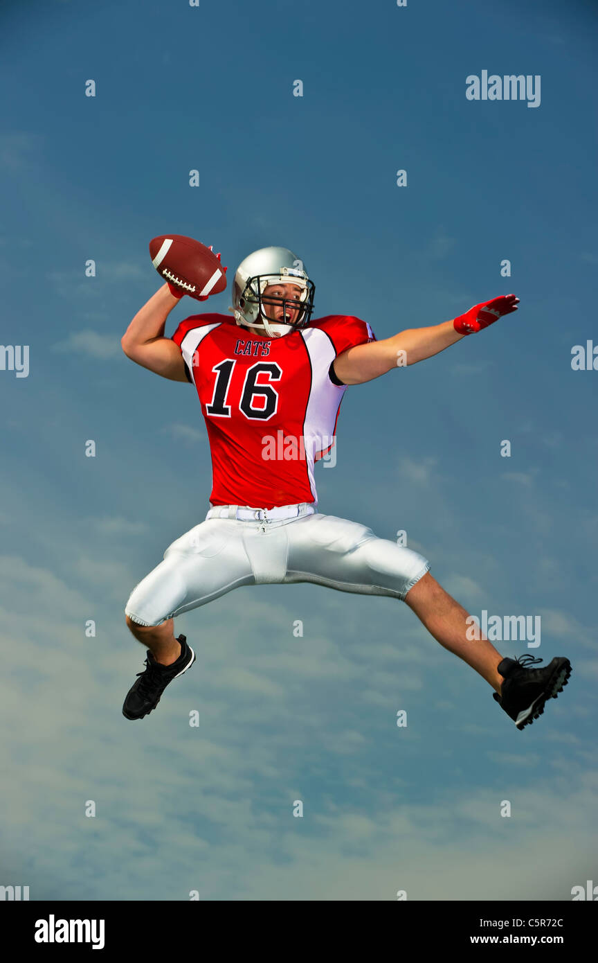 American football player gets ready to throw a pass. - Stock Image