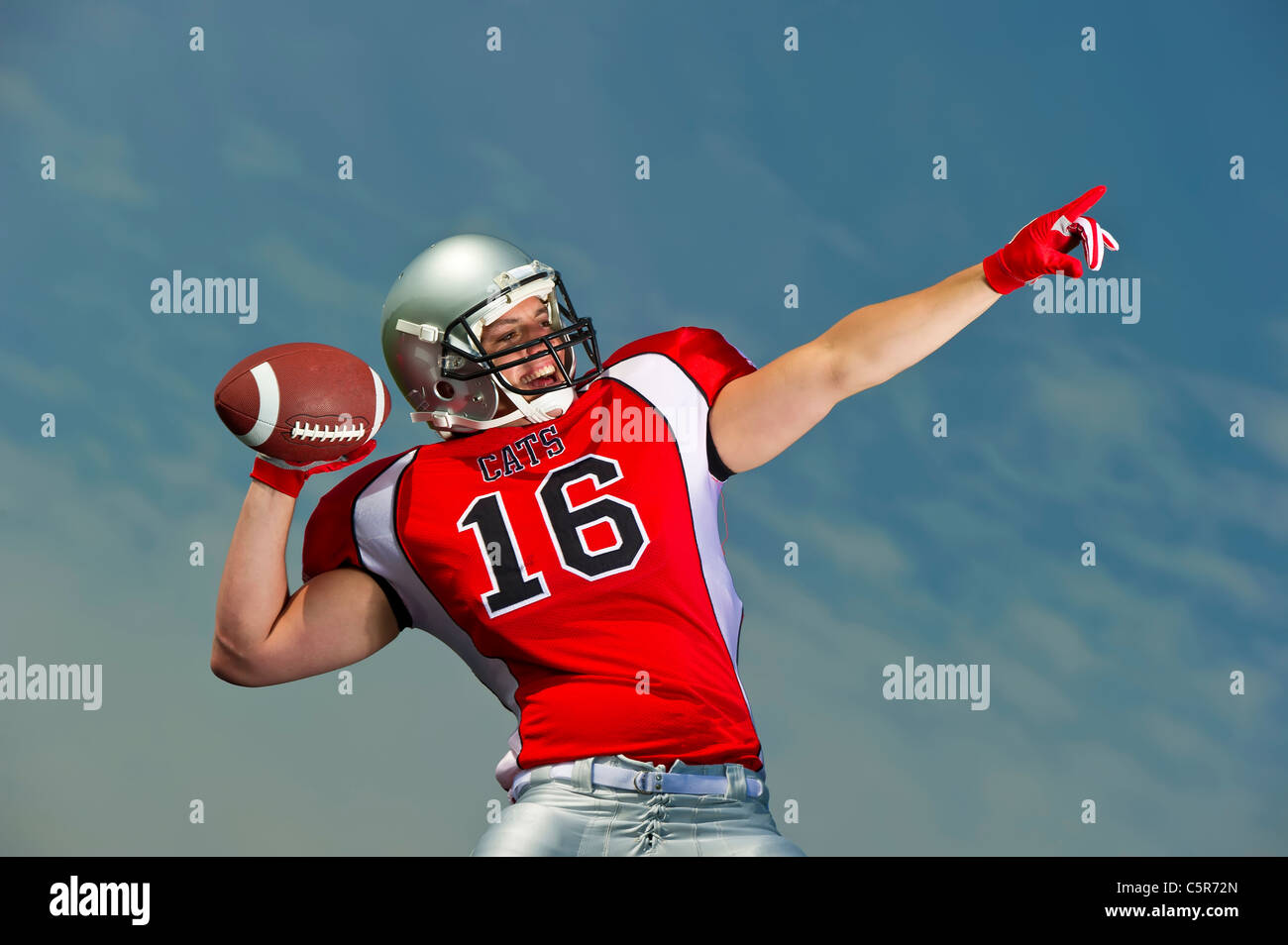 An American Football Quarterback gets ready to throw the pass - Stock Image
