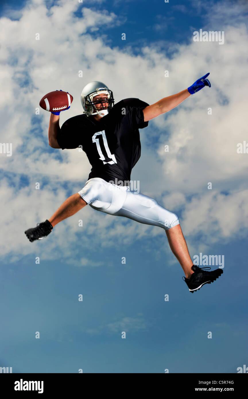 American Football Quarterback looks to make pass. - Stock Image