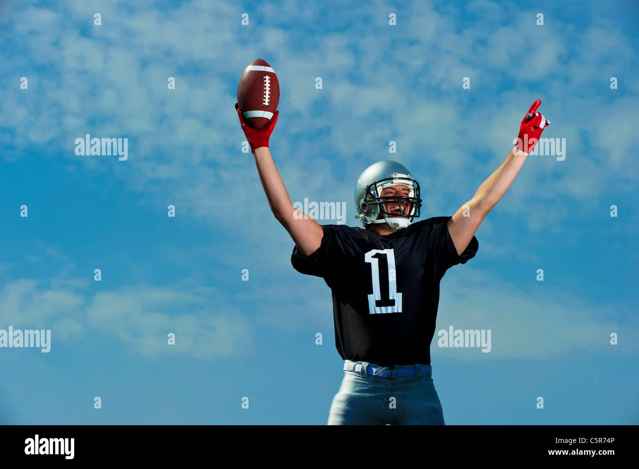 American Footballer celebrates being No'1. - Stock Image